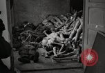 Image of pile of emaciated corpses Germany, 1945, second 60 stock footage video 65675073907