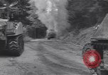 Image of United States M-4 tank on fire Wegscheid Germany, 1945, second 15 stock footage video 65675075890