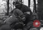 Image of Medic tends to wounded American soldier Wegscheid Germany, 1945, second 8 stock footage video 65675075891