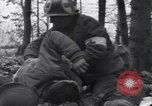 Image of Medic tends to wounded American soldier Wegscheid Germany, 1945, second 10 stock footage video 65675075891