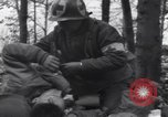 Image of Medic tends to wounded American soldier Wegscheid Germany, 1945, second 12 stock footage video 65675075891