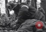 Image of Medic tends to wounded American soldier Wegscheid Germany, 1945, second 13 stock footage video 65675075891