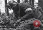 Image of Medic tends to wounded American soldier Wegscheid Germany, 1945, second 14 stock footage video 65675075891
