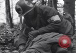 Image of Medic tends to wounded American soldier Wegscheid Germany, 1945, second 15 stock footage video 65675075891