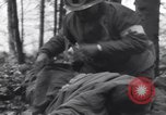Image of Medic tends to wounded American soldier Wegscheid Germany, 1945, second 16 stock footage video 65675075891
