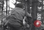 Image of Medic tends to wounded American soldier Wegscheid Germany, 1945, second 17 stock footage video 65675075891