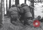 Image of Medic tends to wounded American soldier Wegscheid Germany, 1945, second 27 stock footage video 65675075891