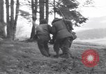 Image of Medic tends to wounded American soldier Wegscheid Germany, 1945, second 29 stock footage video 65675075891