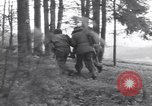 Image of Medic tends to wounded American soldier Wegscheid Germany, 1945, second 30 stock footage video 65675075891