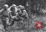 Image of Medic tends to wounded American soldier Wegscheid Germany, 1945, second 33 stock footage video 65675075891