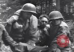 Image of Medic tends to wounded American soldier Wegscheid Germany, 1945, second 36 stock footage video 65675075891