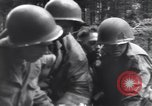 Image of Medic tends to wounded American soldier Wegscheid Germany, 1945, second 37 stock footage video 65675075891
