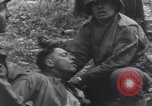 Image of Medic tends to wounded American soldier Wegscheid Germany, 1945, second 43 stock footage video 65675075891