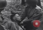 Image of Medic tends to wounded American soldier Wegscheid Germany, 1945, second 44 stock footage video 65675075891