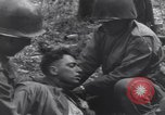 Image of Medic tends to wounded American soldier Wegscheid Germany, 1945, second 46 stock footage video 65675075891