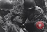 Image of Medic tends to wounded American soldier Wegscheid Germany, 1945, second 47 stock footage video 65675075891