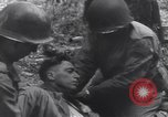 Image of Medic tends to wounded American soldier Wegscheid Germany, 1945, second 48 stock footage video 65675075891