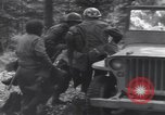 Image of Medic tends to wounded American soldier Wegscheid Germany, 1945, second 53 stock footage video 65675075891