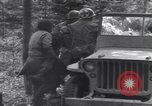 Image of Medic tends to wounded American soldier Wegscheid Germany, 1945, second 54 stock footage video 65675075891