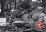Image of Medic tends to wounded American soldier Wegscheid Germany, 1945, second 57 stock footage video 65675075891