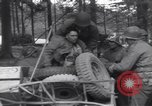 Image of Medic tends to wounded American soldier Wegscheid Germany, 1945, second 60 stock footage video 65675075891