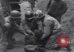 Image of wounded US Soldier tank crew World War 2 Wegscheid Germany, 1945, second 31 stock footage video 65675075892