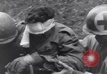 Image of wounded US Soldier tank crew World War 2 Wegscheid Germany, 1945, second 60 stock footage video 65675075892