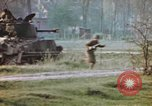Image of U.S. tank firing at building Germany, 1945, second 56 stock footage video 65675076294