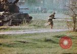 Image of U.S. tank firing at building Germany, 1945, second 60 stock footage video 65675076294