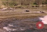 Image of U.S. troops ride on tanks crossing a stream Germany, 1945, second 1 stock footage video 65675076625