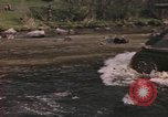 Image of U.S. troops ride on tanks crossing a stream Germany, 1945, second 2 stock footage video 65675076625
