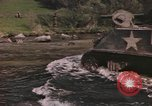 Image of U.S. troops ride on tanks crossing a stream Germany, 1945, second 3 stock footage video 65675076625