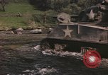 Image of U.S. troops ride on tanks crossing a stream Germany, 1945, second 4 stock footage video 65675076625
