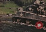 Image of U.S. troops ride on tanks crossing a stream Germany, 1945, second 5 stock footage video 65675076625