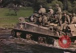 Image of U.S. troops ride on tanks crossing a stream Germany, 1945, second 7 stock footage video 65675076625