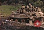 Image of U.S. troops ride on tanks crossing a stream Germany, 1945, second 8 stock footage video 65675076625