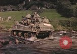 Image of U.S. troops ride on tanks crossing a stream Germany, 1945, second 11 stock footage video 65675076625