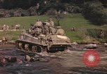 Image of U.S. troops ride on tanks crossing a stream Germany, 1945, second 12 stock footage video 65675076625
