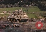 Image of U.S. troops ride on tanks crossing a stream Germany, 1945, second 13 stock footage video 65675076625