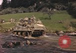 Image of U.S. troops ride on tanks crossing a stream Germany, 1945, second 14 stock footage video 65675076625