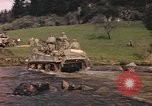 Image of U.S. troops ride on tanks crossing a stream Germany, 1945, second 15 stock footage video 65675076625