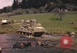 Image of U.S. troops ride on tanks crossing a stream Germany, 1945, second 16 stock footage video 65675076625