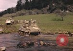 Image of U.S. troops ride on tanks crossing a stream Germany, 1945, second 18 stock footage video 65675076625