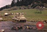 Image of U.S. troops ride on tanks crossing a stream Germany, 1945, second 19 stock footage video 65675076625