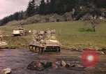 Image of U.S. troops ride on tanks crossing a stream Germany, 1945, second 20 stock footage video 65675076625