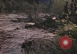 Image of U.S. troops ride on tanks crossing a stream Germany, 1945, second 21 stock footage video 65675076625