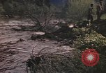 Image of U.S. troops ride on tanks crossing a stream Germany, 1945, second 22 stock footage video 65675076625