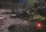 Image of U.S. troops ride on tanks crossing a stream Germany, 1945, second 24 stock footage video 65675076625