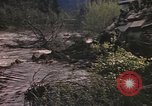 Image of U.S. troops ride on tanks crossing a stream Germany, 1945, second 26 stock footage video 65675076625