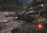 Image of U.S. troops ride on tanks crossing a stream Germany, 1945, second 30 stock footage video 65675076625